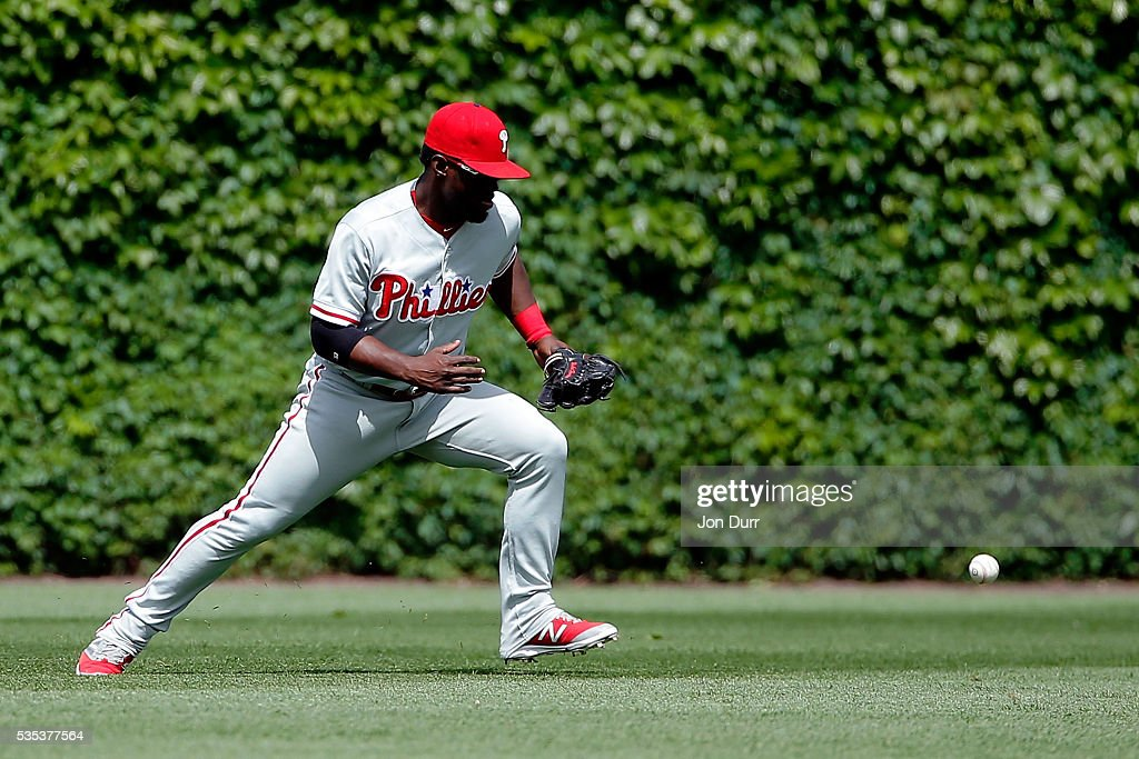 <a gi-track='captionPersonalityLinkClicked' href=/galleries/search?phrase=Odubel+Herrera&family=editorial&specificpeople=13795312 ng-click='$event.stopPropagation()'>Odubel Herrera</a> #37 of the Philadelphia Phillies is unable to field a ball hit by Kris Bryant #17 of the Chicago Cubs (not pictured) to allow Jason Heyward #22 (not pictured) to score during the fifth inning at Wrigley Field on May 29, 2016 in Chicago, Illinois.