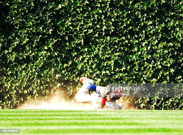 Odubel Herrera of the Philadelphia Phillies makes a catch on Kris Bryant of the Chicago Cubs to save a no hitter during the ninth inning on July 25...