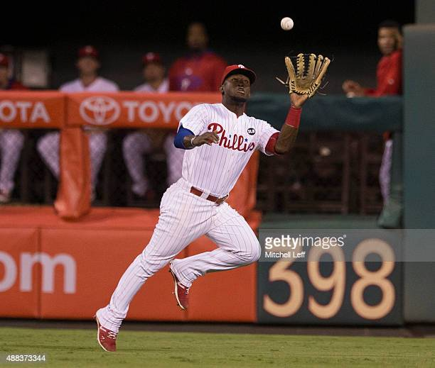 Odubel Herrera of the Philadelphia Phillies makes a running catch in the top of the sixth inning against the Washington Nationals on September 15...