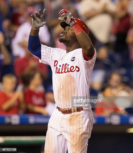 Odubel Herrera of the Philadelphia Phillies reacts after hitting a threerun home run in the bottom of the eighth inning against the Atlanta Braves on...