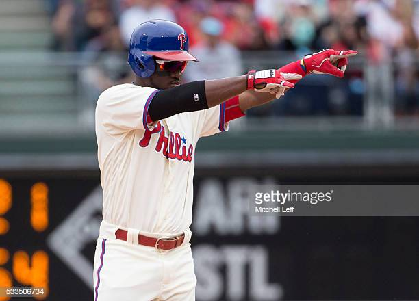 Odubel Herrera of the Philadelphia Phillies reacts after hitting a double in the top of the first inning against the Atlanta Braves at Citizens Bank...