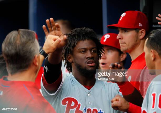 Odubel Herrera of the Philadelphia Phillies reacts after scoring on a single hit by Aaron Altherr in the first inning against the Atlanta Braves at...