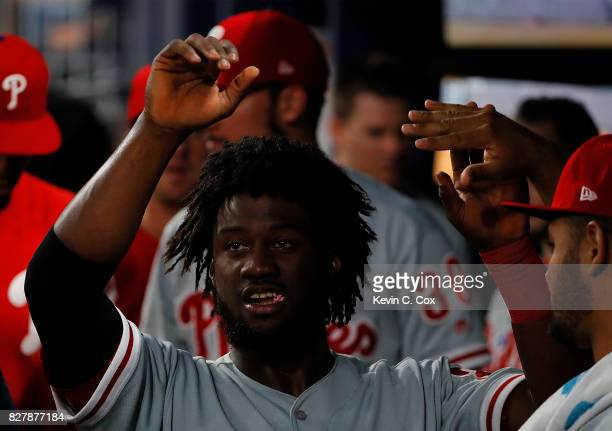 Odubel Herrera of the Philadelphia Phillies reacts after scoring on a RBI double hit by Nick Williams in the fourth inning against the Atlanta Braves...