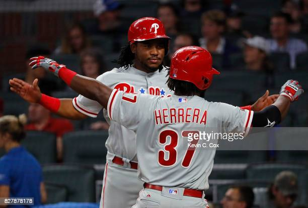 Odubel Herrera of the Philadelphia Phillies reacts with Maikel Franco after hitting a tworun homer in the fifth inning against the Atlanta Braves at...