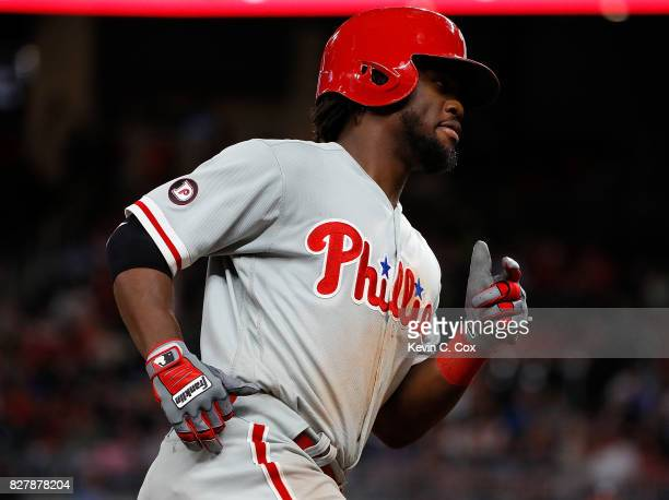 Odubel Herrera of the Philadelphia Phillies rounds third base after hitting a tworun homer in the fifth inning against the Atlanta Braves at SunTrust...