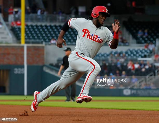 Odubel Herrera of the Philadelphia Phillies rounds third base on the way to scoring on a single hit by Aaron Altherr in the first inning against the...