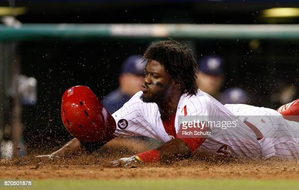Odubel Herrera of the Philadelphia Phillies scores on a sacrifice fly by Cesar Hernandez during the sixth inning of a game against the Milwaukee...