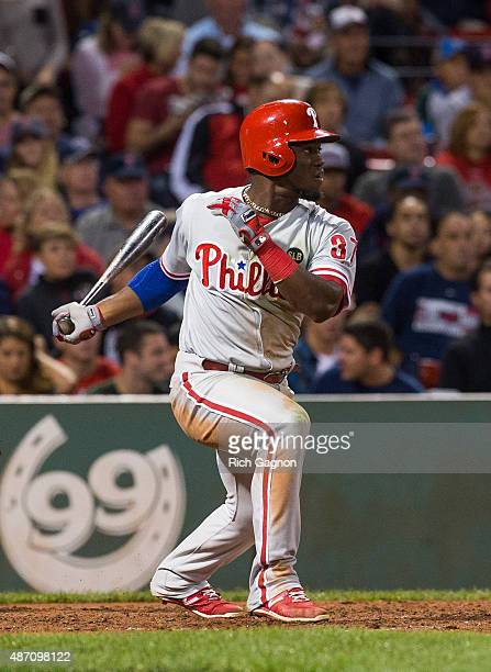 Odubel Herrera of the Philadelphia Phillies singles to center but was thrown out at second as he slid past second base against the Boston Red Sox...