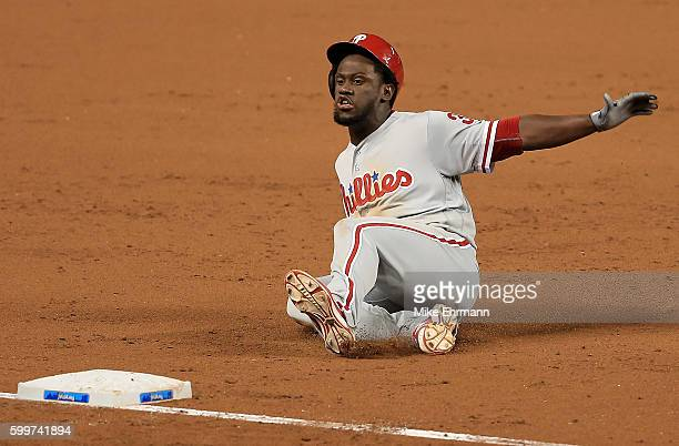 Odubel Herrera of the Philadelphia Phillies slides into third on a triple during a game against the Miami Marlins at Marlins Park on September 6 2016...