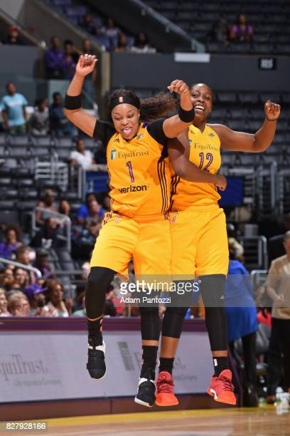Odyssey Sims and Chelsea Gray of the Los Angeles Sparks celebrate during the game against the New York Liberty on August 4 2017 at the STAPLES Center...