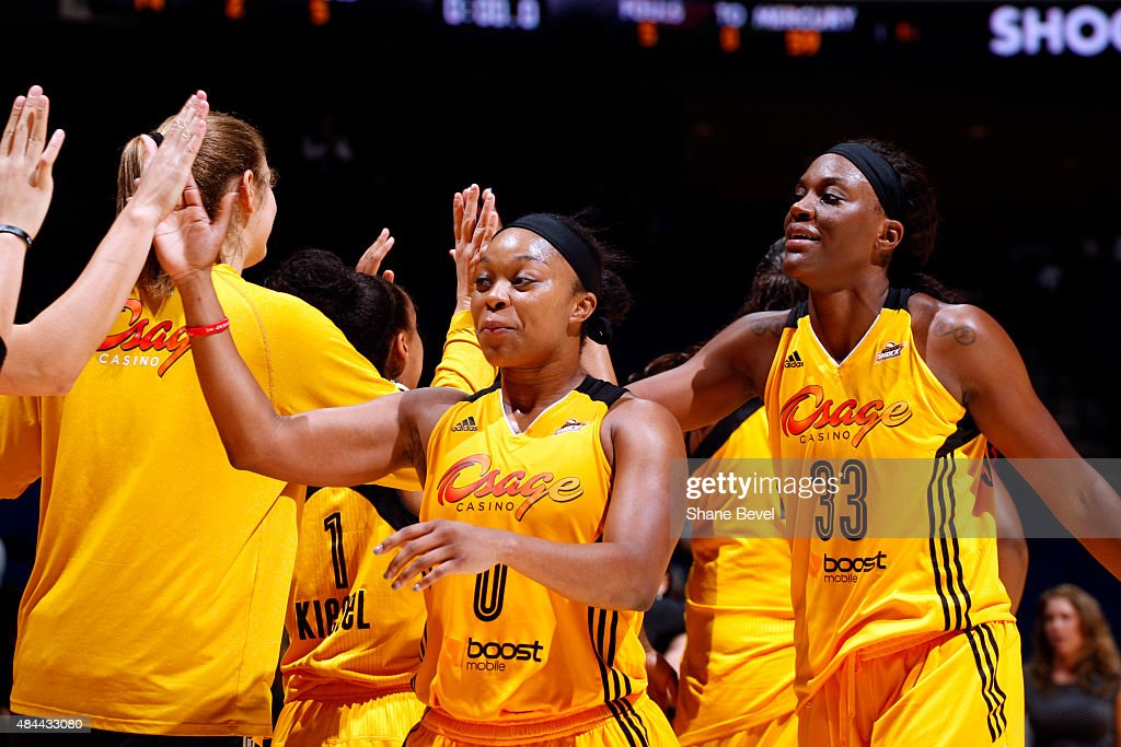 Odyssey Sims and Tiffany JacksonJones of the Tulsa Shock hi five their teammates after a game against the Phoenix Mercury on August 18 2015 at the...
