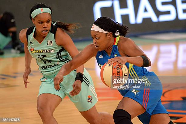 Odyssey Sims of the Dallas Wings handles the ball against Brittany Boyd of the New York Liberty at Madison Square Garden on May 15 2016 in New York...