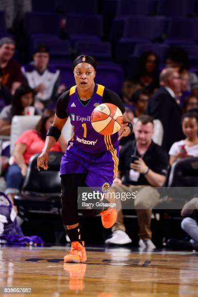 Odyssey Sims of the Los Angeles Sparks brings the ball up court against the Phoenix Mercury on August 24 2017 at Talking Stick Resort Arena in...