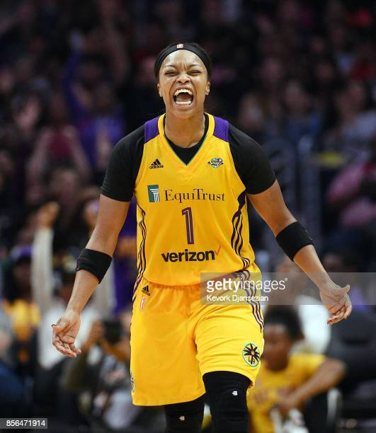 Odyssey Sims of the Los Angeles Sparks celebrates after scoring on a three point basket against Minnesota Lynx during Game Four of WNBA Finals at...