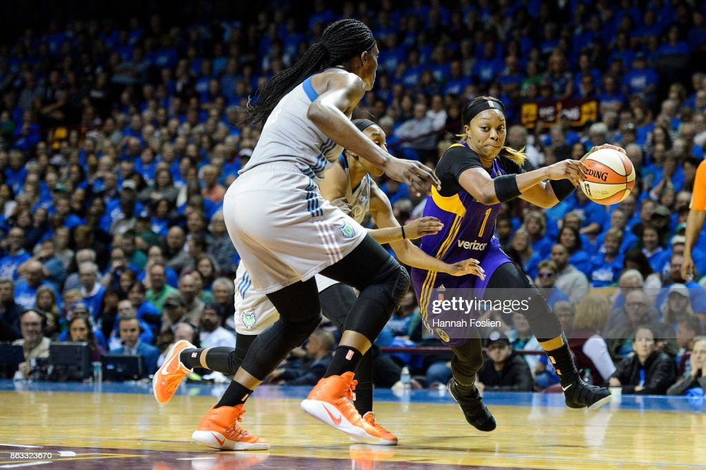 Odyssey Sims #1 of the Los Angeles Sparks drives to the basket against Sylvia Fowles #34 and Renee Montgomery #21 of the Minnesota Lynx during the third quarter of Game Two of the WNBA Finals on September 26, 2017 at Williams in Minneapolis, Minnesota. The Lynx defeated the Sparks 70-68.