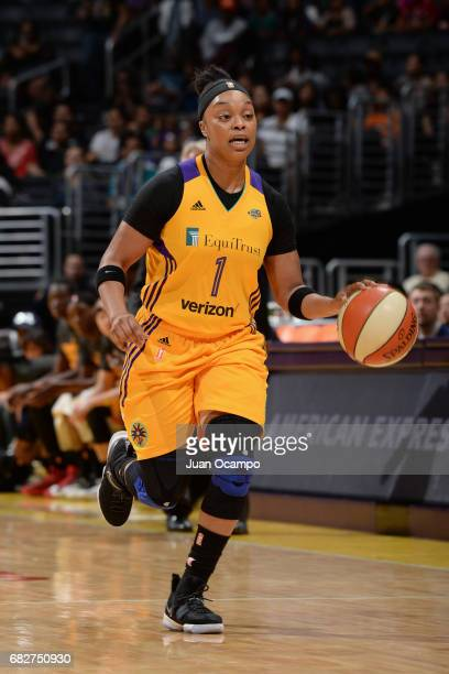 Odyssey Sims of the Los Angeles Sparks handles the ball against the Seattle Storm on May 13 2017 at STAPLES Center in Los Angeles California NOTE TO...
