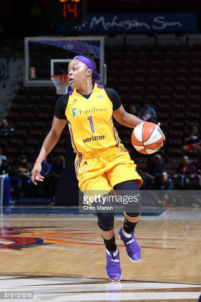 Odyssey Sims of the Los Angeles Sparks handles the ball during a game against the Connecticut Sun on May 3 2017 at Mohegan Sun Arena in Uncasville...