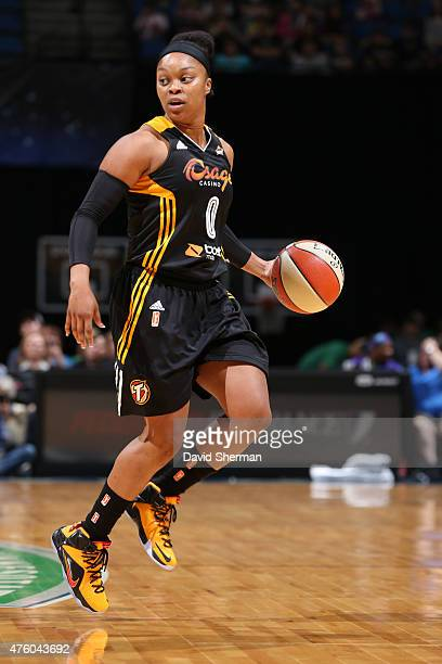 Odyssey Sims of the Tulsa Shock dribbles against the Minnesota Lynx during the season opener of their WNBA game on June 5 2015 at Target Center in...