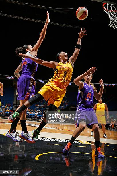 Odyssey Sims of the Tulsa Shock dribbles the ball against the Phoenix Mercury during Game Two of the WNBA Western Conference Semifinals on September...