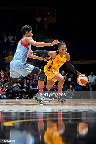 Odyssey Sims of the Tulsa Shock drives against Angel McCoughtry of the Atlanta Dream during the WNBA game on July 31 2014 at the BOK Center in Tulsa...
