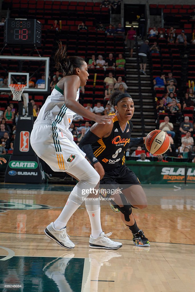 <a gi-track='captionPersonalityLinkClicked' href=/galleries/search?phrase=Odyssey+Sims&family=editorial&specificpeople=7412276 ng-click='$event.stopPropagation()'>Odyssey Sims</a> #0 of the Tulsa Shock drives against the Seattle Storm during the game on August 10,2014 at Key Arena in Seattle, Washington.