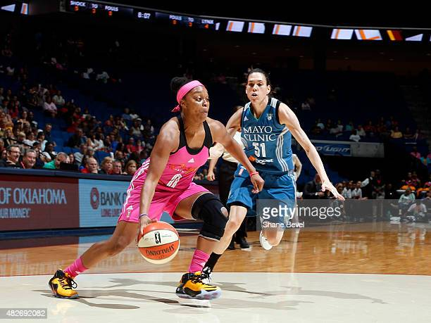 Odyssey Sims of the Tulsa Shock drives to the basket against Anna Cruz of the Minnesota Lynx on August 1 2015 at the BOK Center in Tulsa Oklahoma...