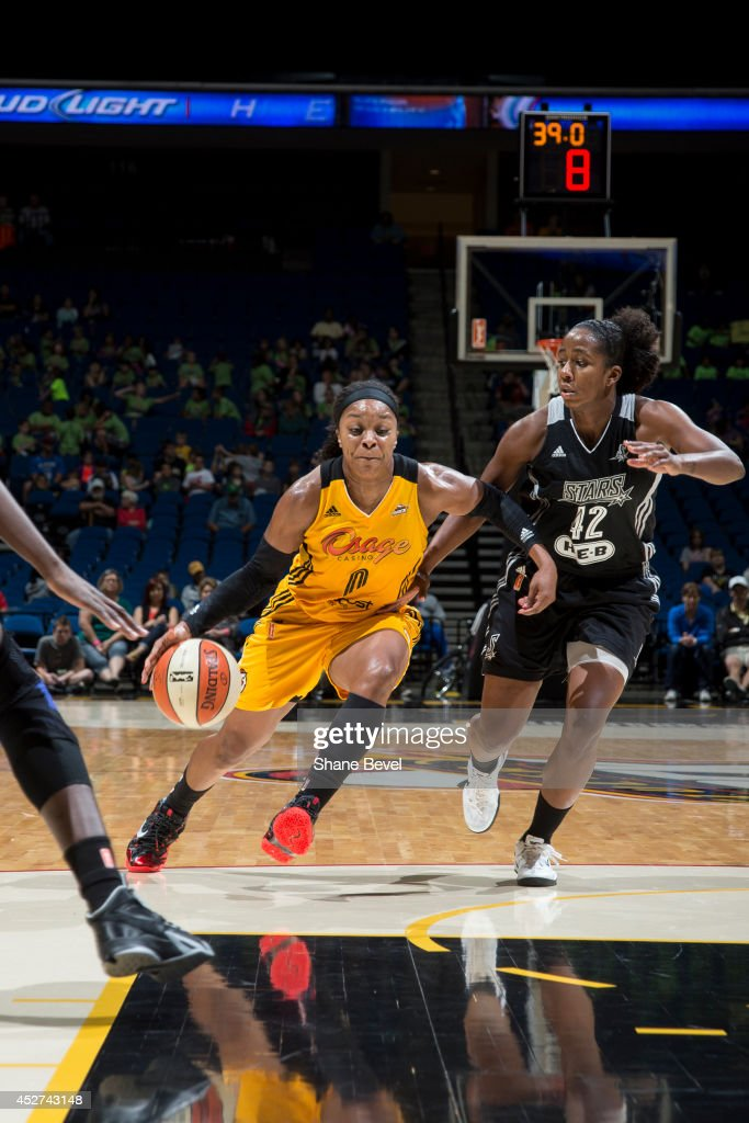 <a gi-track='captionPersonalityLinkClicked' href=/galleries/search?phrase=Odyssey+Sims&family=editorial&specificpeople=7412276 ng-click='$event.stopPropagation()'>Odyssey Sims</a> #0 of the Tulsa Shock drives to the basket against Shenise Johnson #42 of the San Antonio Stars during the WNBA game on July 17, 2014 at the BOK Center in Tulsa, Oklahoma.