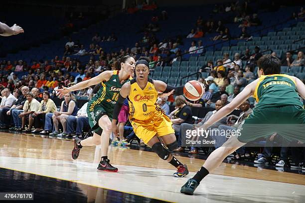 Odyssey Sims of the Tulsa Shock drives to the basket against Sue Bird of the Seattle Storm on June 9 2015 at the BOK Center in Tulsa Oklahoma NOTE TO...