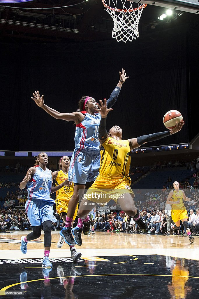<a gi-track='captionPersonalityLinkClicked' href=/galleries/search?phrase=Odyssey+Sims&family=editorial&specificpeople=7412276 ng-click='$event.stopPropagation()'>Odyssey Sims</a> #0 of the Tulsa Shock drives to the basket against Tiffany Hayes #15 of the Atlanta Dream during the WNBA game on July 29, 2014 at the BOK Center in Tulsa, Oklahoma.