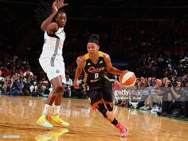 Odyssey Sims of the Tulsa Shock drives to the basket against Tina Charles of the New York Liberty on August 15 2015 at Madison Square Garden New York...