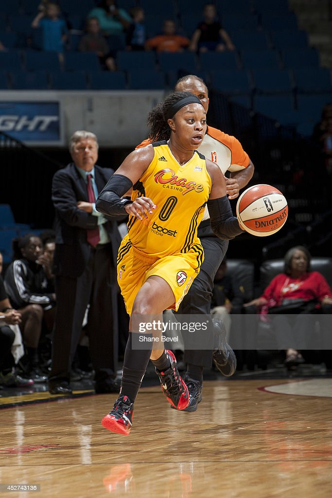 Odyssey Sims #0 of the Tulsa Shock drives up-court against the San Antonio Stars during the WNBA game on July 17, 2014 at the BOK Center in Tulsa, Oklahoma.