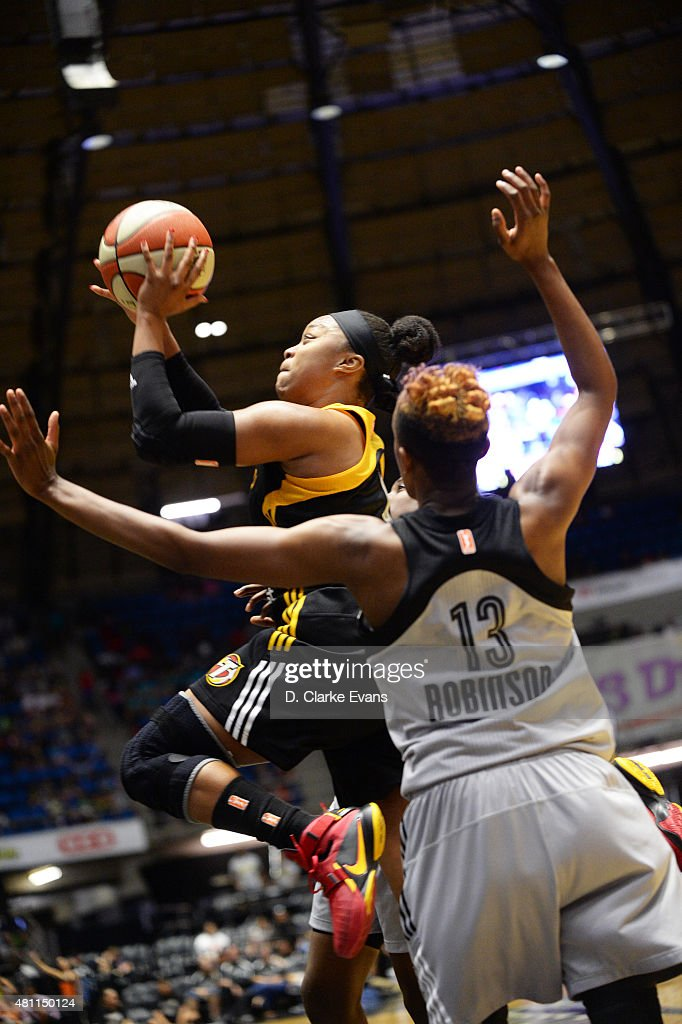 <a gi-track='captionPersonalityLinkClicked' href=/galleries/search?phrase=Odyssey+Sims&family=editorial&specificpeople=7412276 ng-click='$event.stopPropagation()'>Odyssey Sims</a> #0 of the Tulsa Shock goes up for a shot against the San Antonio Stars at the Freeman Coliseum in San Antonio, TX on July 17, 2015 in San Antonio, Texas.