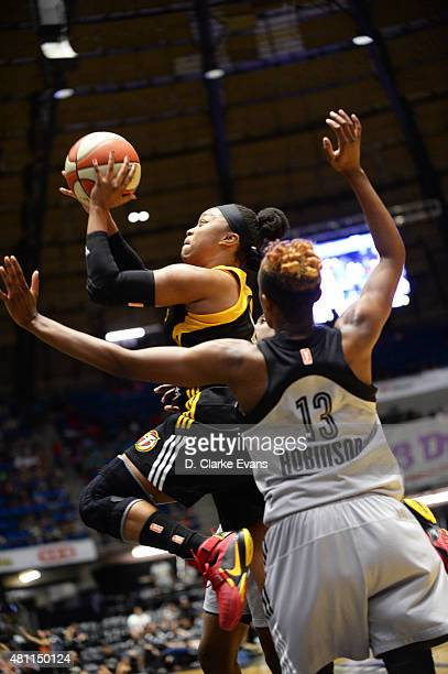 Odyssey Sims of the Tulsa Shock goes up for a shot against the San Antonio Stars at the Freeman Coliseum in San Antonio TX on July 17 2015 in San...