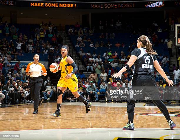 Odyssey Sims of the Tulsa Shock handles the ball against Becky Hammon of the San Antonio Stars during the WNBA game on August 8 2014 at the BOK...