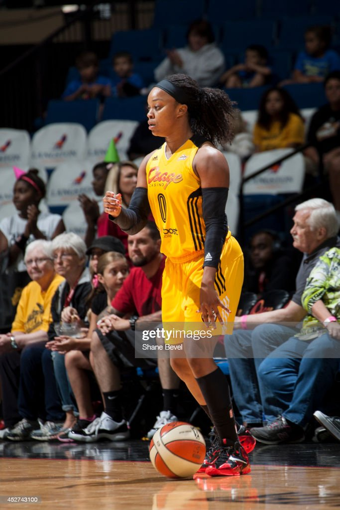 <a gi-track='captionPersonalityLinkClicked' href=/galleries/search?phrase=Odyssey+Sims&family=editorial&specificpeople=7412276 ng-click='$event.stopPropagation()'>Odyssey Sims</a> #0 of the Tulsa Shock handles the ball against the San Antonio Stars during the WNBA game on July 17, 2014 at the BOK Center in Tulsa, Oklahoma.