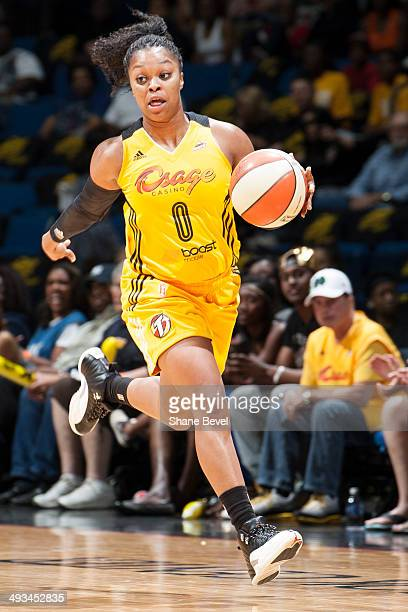 Odyssey Sims of the Tulsa Shock moves the ball downcourt during the WNBA game against the Minnesota Lynx on May 23 2014 at the BOK Center in Tulsa...