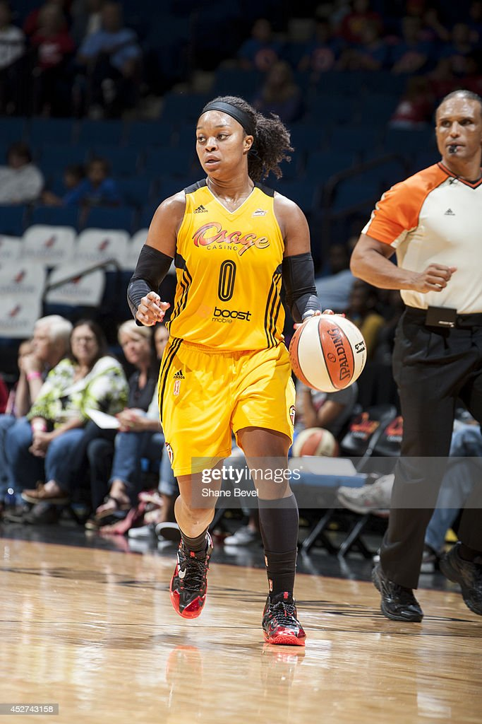 <a gi-track='captionPersonalityLinkClicked' href=/galleries/search?phrase=Odyssey+Sims&family=editorial&specificpeople=7412276 ng-click='$event.stopPropagation()'>Odyssey Sims</a> #0 of the Tulsa Shock moves the ball up-court against the San Antonio Stars during the WNBA game on July 17, 2014 at the BOK Center in Tulsa, Oklahoma.