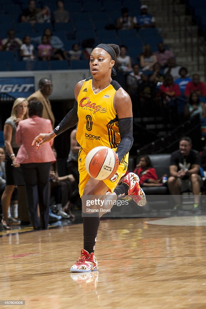 Odyssey Sims #0 of the Tulsa Shock moves the ball up-court against the Chicago Sky on July 27, 2014 at the BOK Center in Tulsa, Oklahoma.