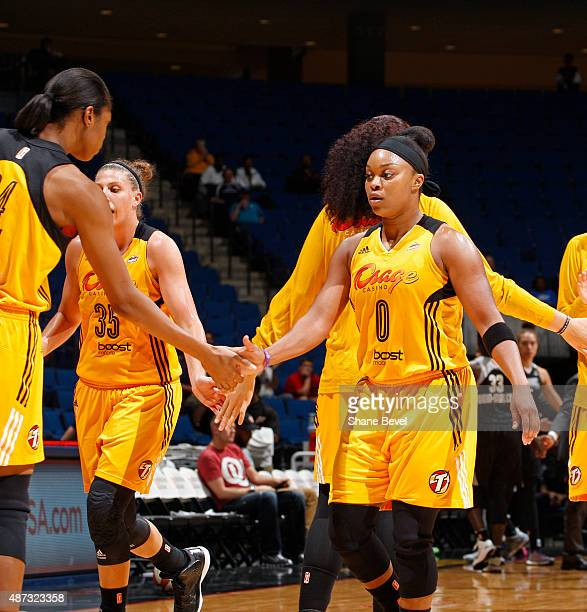Odyssey Sims of the Tulsa Shock shakes her teammates hands after the game against the San Antonio Stars on September 8 2015 at the BOK Center in...