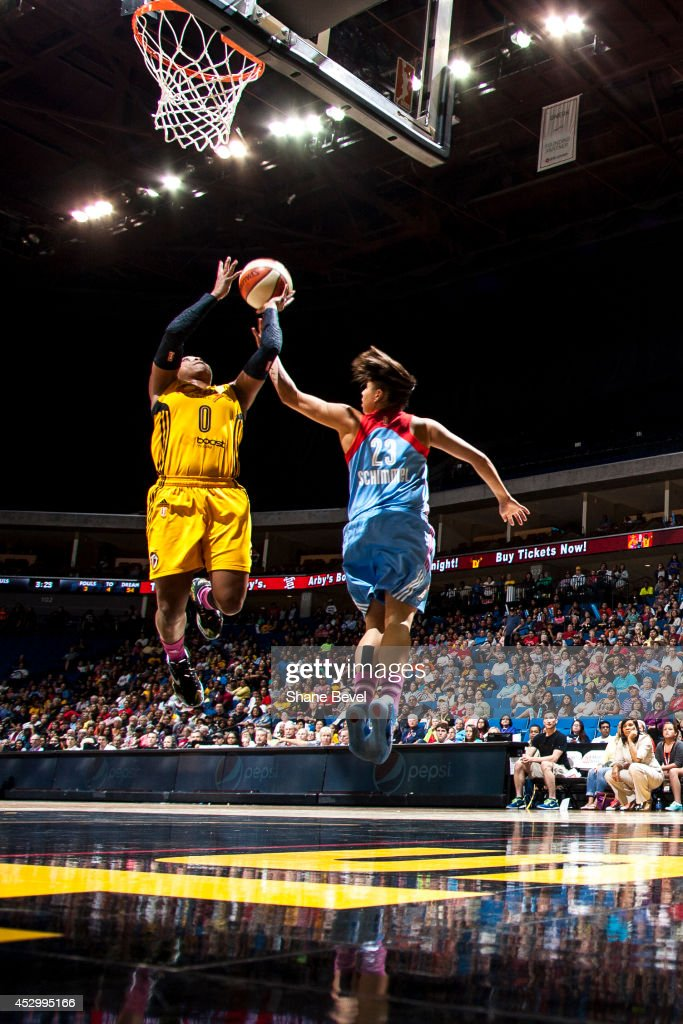 Odyssey Sims #0 of the Tulsa Shock shoots against Shoni Schimmel #23 of the Atlanta Dream during the WNBA game on July 31, 2014 at the BOK Center in Tulsa, Oklahoma.