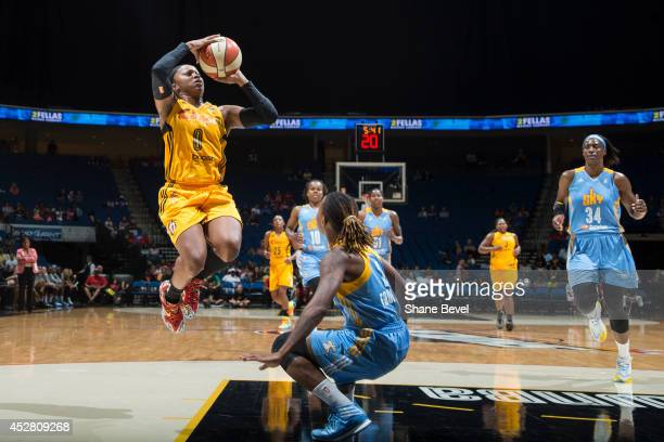 Odyssey Sims of the Tulsa Shock shoots against the Chicago Sky on July 27 2014 at the BOK Center in Tulsa Oklahoma NOTE TO USER User expressly...