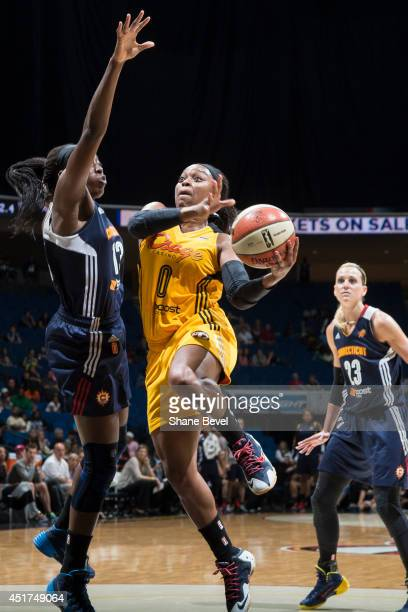 Odyssey Sims of the Tulsa Shock shoots against the Connecticut Sun during the WNBA game on July 5 2014 at the BOK Center in Tulsa Oklahoma NOTE TO...