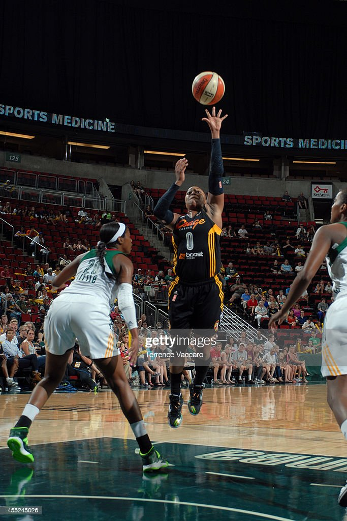 <a gi-track='captionPersonalityLinkClicked' href=/galleries/search?phrase=Odyssey+Sims&family=editorial&specificpeople=7412276 ng-click='$event.stopPropagation()'>Odyssey Sims</a> #0 of the Tulsa Shock shoots the ball against Camille Little #20 of the Seattle Storm during the game on August 10,2014 at Key Arena in Seattle, Washington.