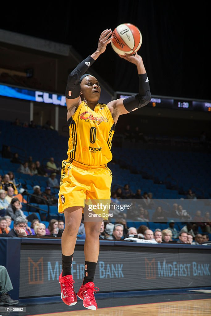<a gi-track='captionPersonalityLinkClicked' href=/galleries/search?phrase=Odyssey+Sims&family=editorial&specificpeople=7412276 ng-click='$event.stopPropagation()'>Odyssey Sims</a> #0 of the Tulsa Shock takes a shot against the San Antonio Stars during the WNBA game on May 22, 2015 at the BOK Center in Tulsa, Oklahoma.