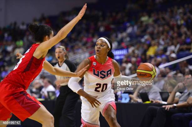 Odyssey Sims of the USA Basketball Women's National Team dribbles the basketball against the Canadian Basketball Women's National Team on September...