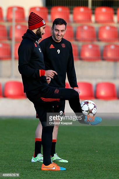 Oemer Toprak and Josip Drmic of Leverkusen attend a Bayer Leverkusen training session ahead of their UEFA Champions League Group C match between...