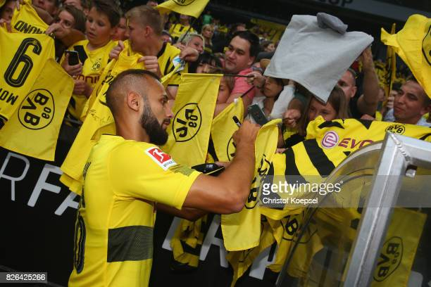 Oemer Toprak gives autographs during the Borussia Dortmund Season Opening 2017/18 at Signal Iduna Park on August 4 2017 in Dortmund Germany