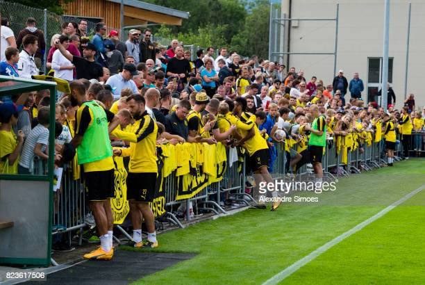 Oemer Toprak Gonzalo Castro Marc Bartra and PierreEmerick Aubameyang of Borussia Dortmund are giving autographs to the fans after a training session...