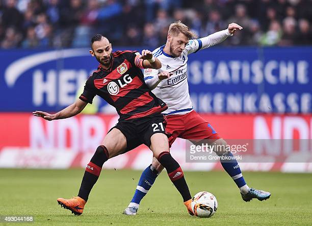 Oemer Toprak of Bayer Leverkusen and Aaron Hunt of Hamburger SV battle for the ball during the Bundesliga match between Hamburger SV and Bayer...