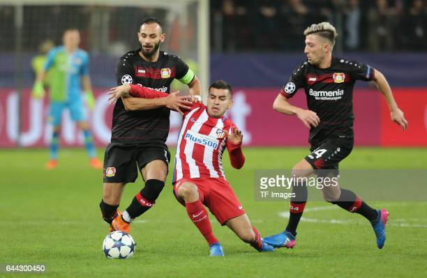 Oemer Toprak of Bayer Leverkusen and Angel Correa of Atletico Madrid controls the ball during the UEFA Champions League Round of 16 first leg match...